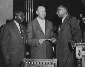 Reverend C.K. Steele accepting a check given to him by Reverend Raymond Henderson.