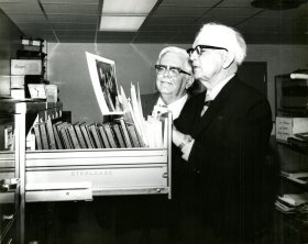 Spessard Holland and Allen Morris looking at a photograph from Holland's governorship from the collection given to Strozier Library in 1971