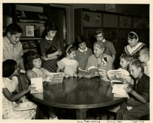 Lois Lenski with children at the Amos Public Library, Sidney, Ohio, 1961. [See Full Description]