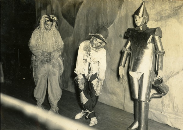 Cornelia Watson, Carolyn Mims, and Joan Kennedy in Wizard of Oz Costumes at Odd Demonstration (L. Janet Wells Scrapbook, 1938-1942)