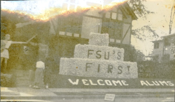 """Homecoming Prop Outside Pi Beta Phi House, """"FSU's First, Welcome Alums"""" (Lillian M. Mandyck Photograph Album, 1948)"""