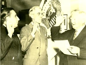 From left to right, Claude Pepper and Charles O. Andrews are sworn in to office by Vice President John Nance Garner, January 5, 1937.