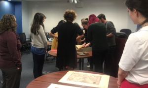 (Photo credit: Rebecca Bramlett) Prof. Leitch's Renaissance Observation class examining Peter Apian's Cosmographia, published in 1584