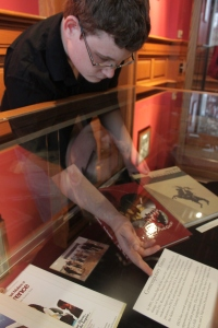 HPUA Student Assistant, Colin Behrens, works on installing exhibit