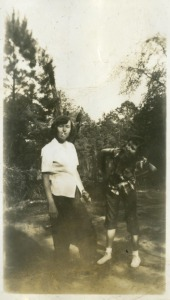 Marjorie Fogarty and Janie Mattison smoking cigarettes with rolled up pants, two prohibited activities (Marjorie Fogarty Lee Collection, HP 2007-014)