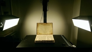 Oversized book of hymnals from the 1600s, Breviarium Romanum, being digitized in the Digital Production Studio