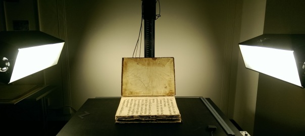 Oversized book being digitized in the production studio