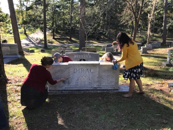 Cleaning Dirac's headstone at Roselawn Cemetery, October 30, 2018