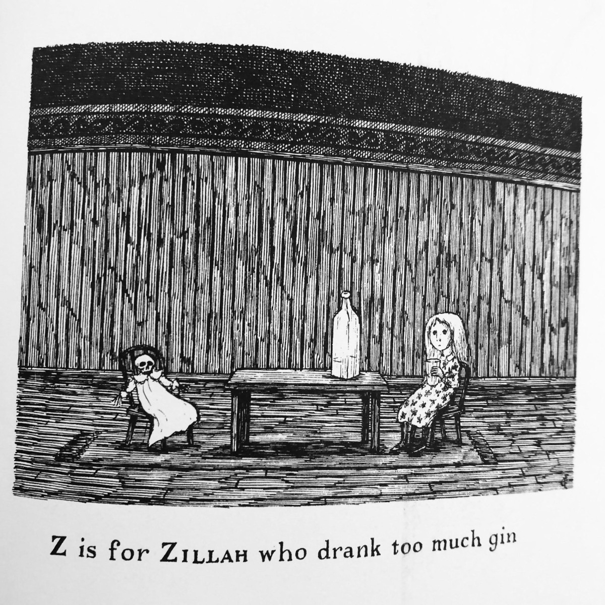"""Black and white illustration taken from The Gashlycrumb Tinies of a two little girls at a table, one skeletal and dead, presumably related to the large bottle atop the table. It is captioned """"Z is for Zillah who drank too much gin."""""""