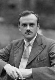 Formal portrait of Paul Dirac sitting outside.