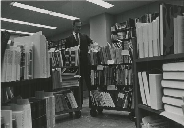 Librarian with Book Carts, ca. 1940s
