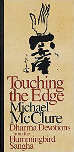 A tan book cover with a black spine, with alternating color text on the cover: Touching the Edge (burgundy, very large), Michael McClure (Black, Very large), Dharma Devotions from the Hummingbird Sangha (Burgundy, smaller). Text is under an image that appears to be a hand arising out of some kind of script or inky shape.