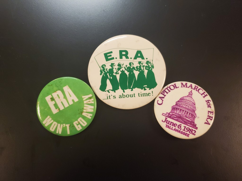 Three Equal Rights Amendment buttons.