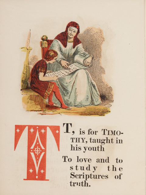 """Page from a book with an illustration of a man in a long robe showing a young boy a scroll. Text beneath the illustration reads: """"T, is for Timothy, taught in his youth to love and to study the Scriptures of truth."""""""